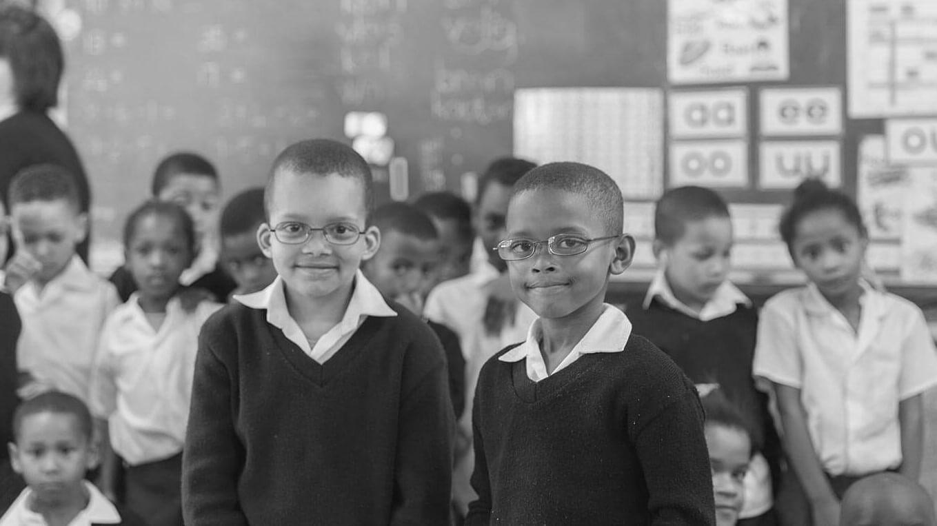 Kids wearing glasses in classroom