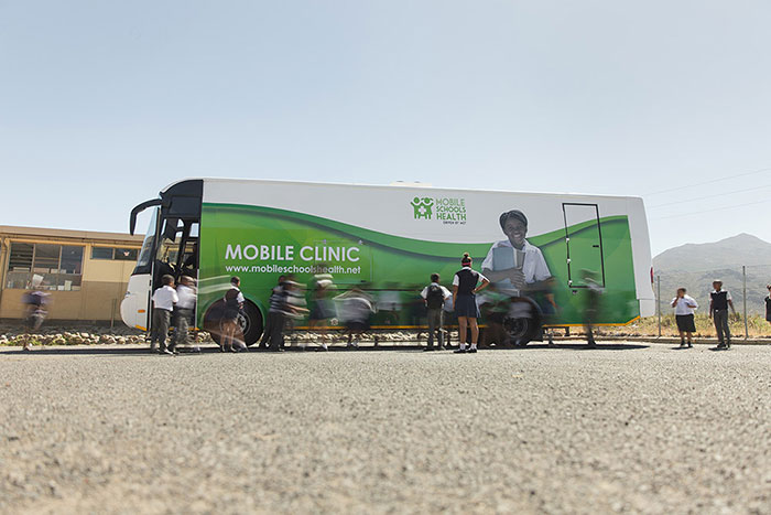 Mobile clinic parked at a school