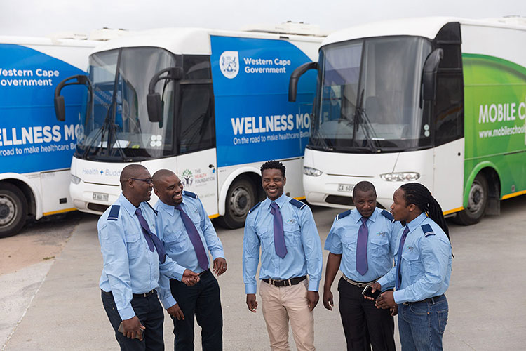 Employee operators standing next to mobile units